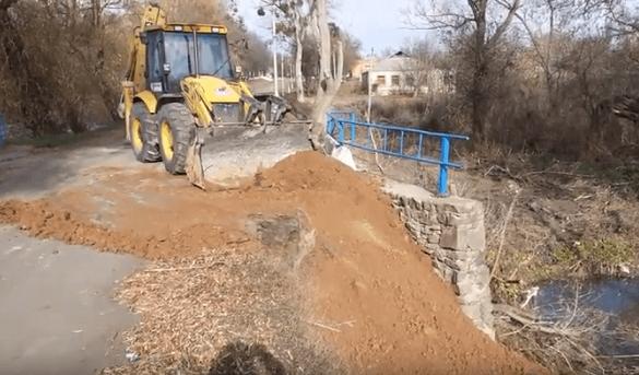 На Черкащині відновлюють пошкоджений зливами міст (ВІДЕО)